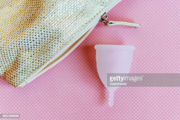Menstrual cup on pink background