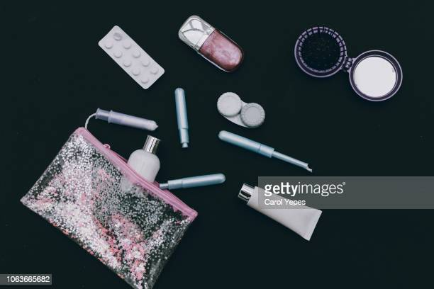 menstrual tampons and pads in cosmetic bag. menstruation time. hygiene and protection - toiletries stock pictures, royalty-free photos & images
