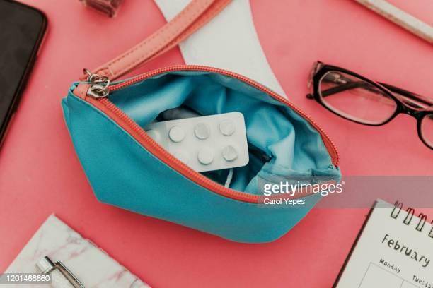 menstrual tampons and pads in cosmetic bag. menstruation time. hygiene and protection - menstruation gesundheitswesen und medizin stock-fotos und bilder