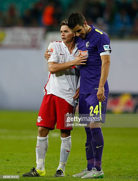 Mensur Mujdza of Freiburg hugs Dominik Kaiser of Leipzig after the Second Bundesliga match between RB Leipzig and SC Freiburg at Red Bull Arena on...