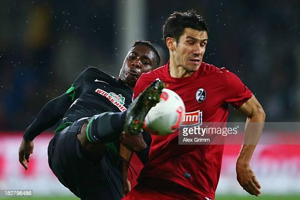 Mensur Mujdza of Freiburg is challenged by Eljero Elia of Bremen during the Bundesliga match between SC Freiburg and SV Werder Bremen at MAGE SOLAR...