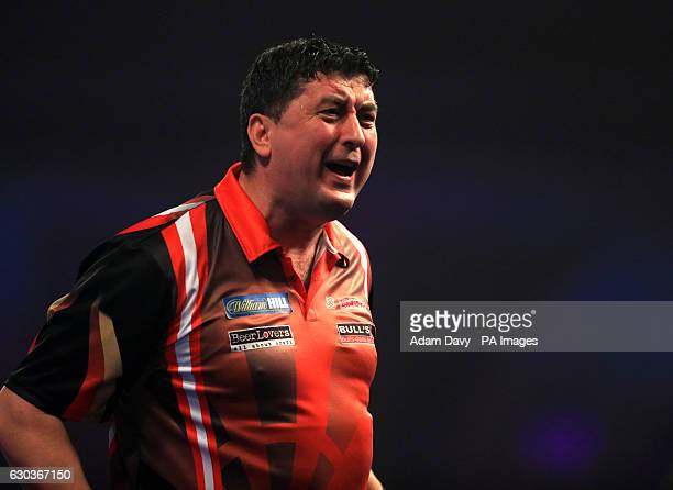 Mensur Suljovic celebrates his win during day seven of the William Hill World Darts Championship at Alexandra Palace London