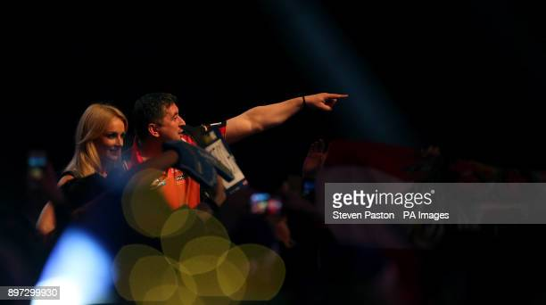 Mensur Suljovic during the walk on during day nine of the William Hill World Darts Championship at Alexandra Palace London