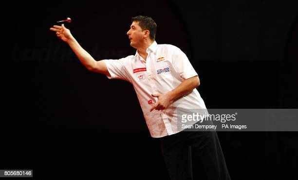 Mensur Suljovic in action against Kevin Painter during the Ladbrokescom World Darts Championship at Alexandra Palace London