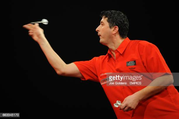 Mensur Suljovic in action against Mark Dudbridge during their second round match