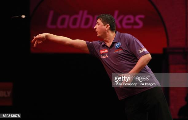 Mensur Suljovic in action against Mark Webster during day seven of The Ladbrokes World Darts Championship at Alexandra Palace London