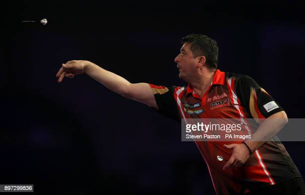 Mensur Suljovic in action during day nine of the William Hill World Darts Championship at Alexandra Palace London