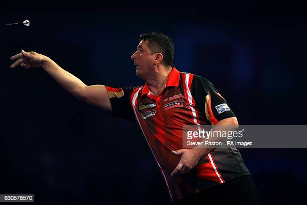 Mensur Suljovic in action during day ten of the William Hill World Darts Championship at Alexandra Palace London