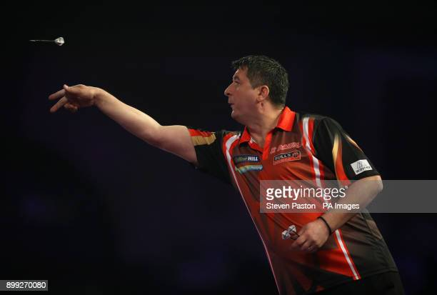 Mensur Suljovic in action during day twelve of the William Hill World Darts Championship at Alexandra Palace London