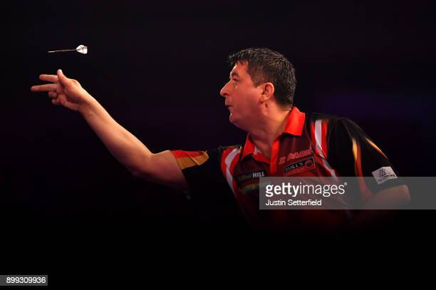 Mensur Suljovic in action during his Third Round Match against Dimitri Van Den Bergh during the 2018 William Hill PDC World Darts Championships on...