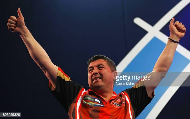 Mensur Suljovic of Austria appreciates the crowd as he walks on stage prior to the second round match against Robert Thornton of Scotland on day nine...