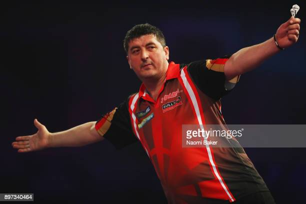 Mensur Suljovic of Austria celebrates after winning a set during the second round match against Robert Thornton of Scotland on day nine of the 2018...