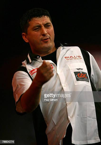 Mensur Suljovic of Austria celebrates winning a set during the first round match between Andy Smith of England and Mensur Suljovic of Austria during...