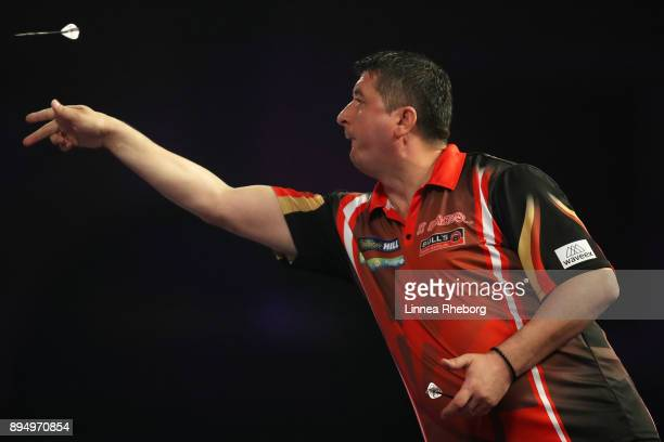 Mensur Suljovic of Austria in action during his first round match against Kevin Painter of England on day five of the 2018 William Hill PDC World...
