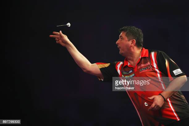 Mensur Suljovic of Austria in action during the second round match against Robert Thornton of Scotland on day nine of the 2018 William Hill PDC World...