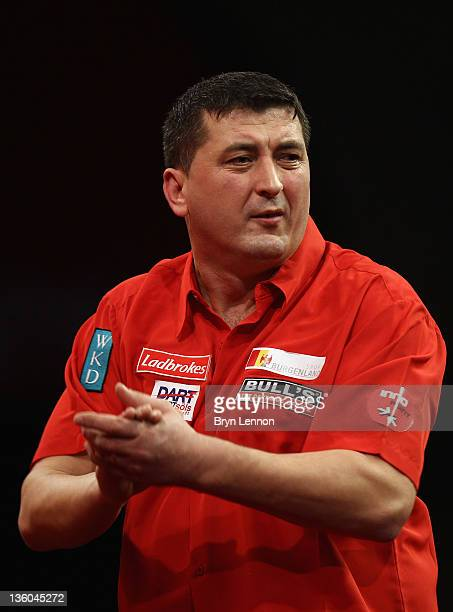 Mensur Suljovic of Austria reacts during his game against Paul Nicholson of Great Britain in their first round match on day three of the 2012...