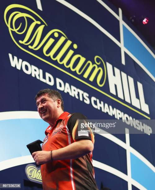 Mensur Suljovic of Austria walks off the stage after winning the second round match against Robert Thornton of Scotland on day nine of the 2018...