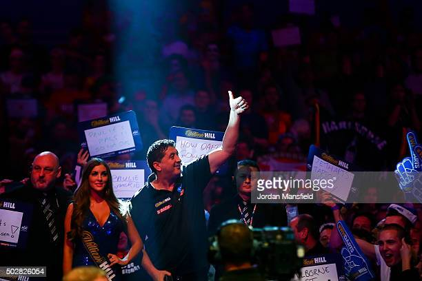 Mensur Suljovic of Austria walks on ahead of his third round match against Adrian Lewis of England on Day Eleven of the 2016 William Hill PDC World...