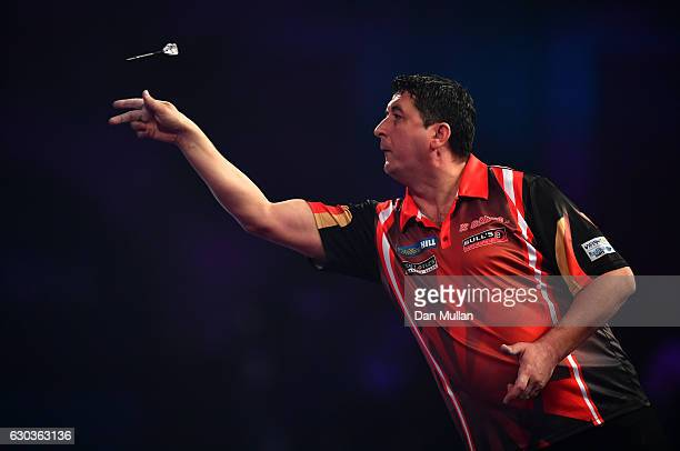 Mensur Suljovic of Serbia throws during his first round match against Ron Meulenkamp of the Netherlands on day seven of the 2017 William Hill PDC...