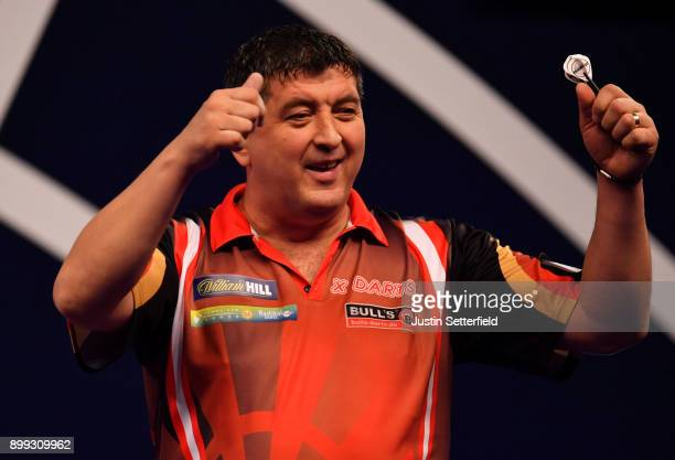Mensur Suljovic reacts during his Third Round Match against Dimitri Van Den Bergh during the 2018 William Hill PDC World Darts Championships on Day...