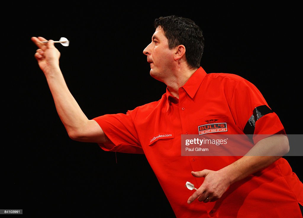 Mensur Suljovic throws a dart during the first round match between Peter Manley of England and Mensur Suljovic of Austria during the 2009 Ladbrokes.com PDC World Darts Championship at Alexandra Palace on December 21, 2008 in London, England.