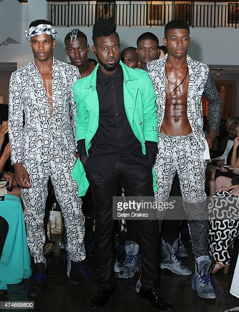 Menswear designer Dexter Pottinger poses on the runway with models after his show during StyleWeek Jamaica 2015 at the National Gallery of Jamaica on...