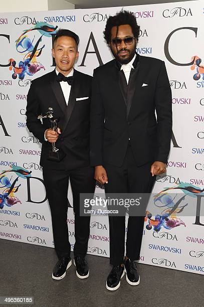 Menswear designer of the year award recipients designers DaoYi Chow and Maxwell Osborne of Public School attend the winners walk during the 2014 CFDA...