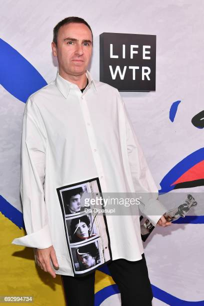 Menswear Designer of the Year Winner and Womenswear Designer of the Year Winner Raf Simons for Calvin Klein poses on the LIFEWTR Winner's Walk at the...