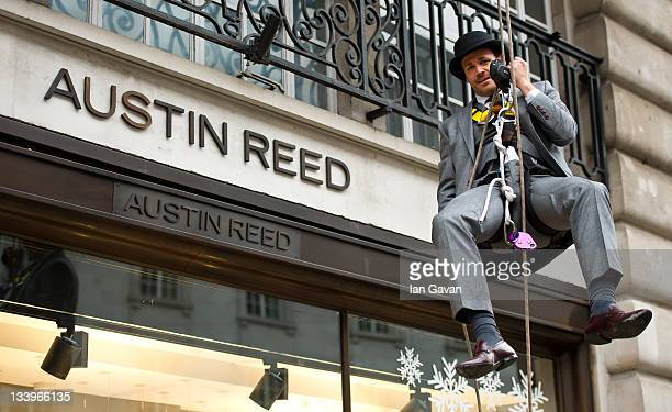 Menswear designer Ryan Hackett abseils down Austin Reed and Viyella Flagship store to mark historic Regent Street opening at 100 Regent Street on...