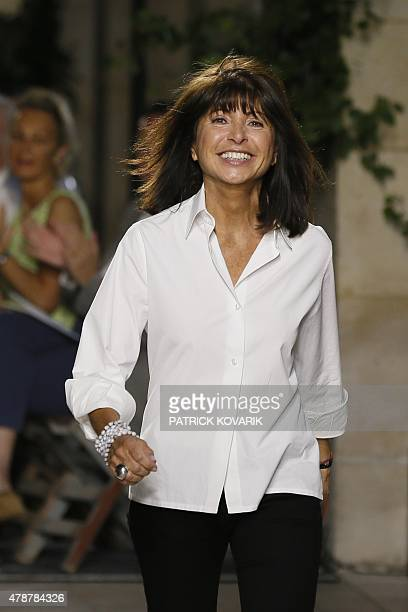 Menswear fashion designer for Hermes Veronique Nichanian acknowledges the audience after the men's SpringSummer collection fashion show in Paris on...