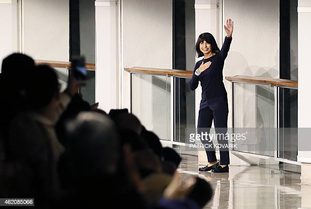 Menswear fashion designer for Hermes Veronique Nichanian greets the audience after the men's Fall/Winter 2015 readytowear collection fashion show in...