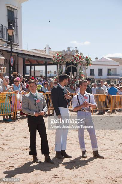 Menswear in El Rocio. Volunteers of the Parent Brotherhood of Almonte, dressed in different costumes, help with organizing the presentations of the...