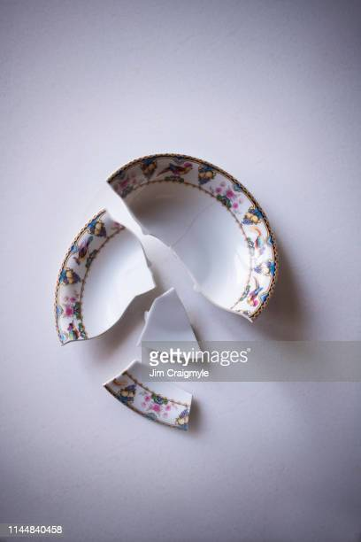 mental health, antique bowl whole, broken and cracked, pieces put back together incorectly and then whole again but still showing cracks. - suicide stock pictures, royalty-free photos & images