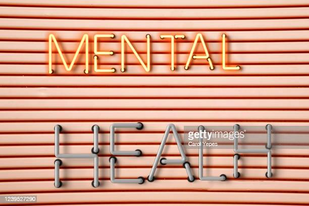 mental health banner in neon lights - help single word stock pictures, royalty-free photos & images