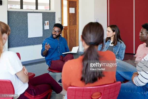 mental health instructor advising to students - education stock pictures, royalty-free photos & images