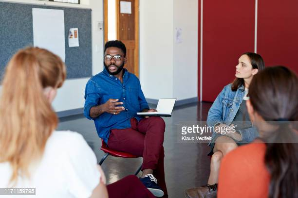 mental health professional advising to students - instructor stock pictures, royalty-free photos & images