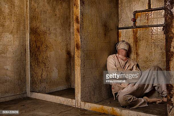 mental patient in the shower - straight jacket stock pictures, royalty-free photos & images