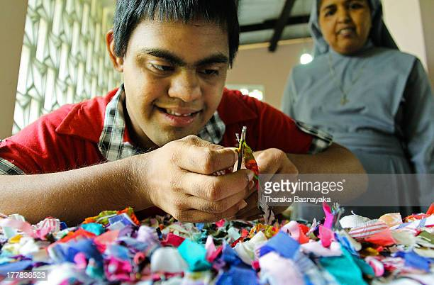 CONTENT] A mentally challenged child threads a needle to design a Carpet made of cloths while one of the Catholic Nuns who guide these children looks...