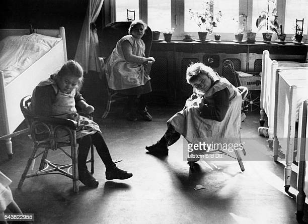 Mentally ill girls sitting in their room, probably in the Mental hospital in Ursberg, Swabia- Photographer: Wolfgang Weber- published by Berliner...