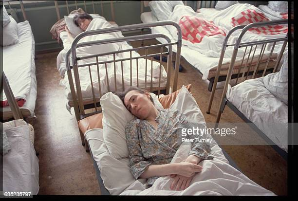 Mentallyill patients rest in their beds at the Gilyarovsky Psychiatric Clinic