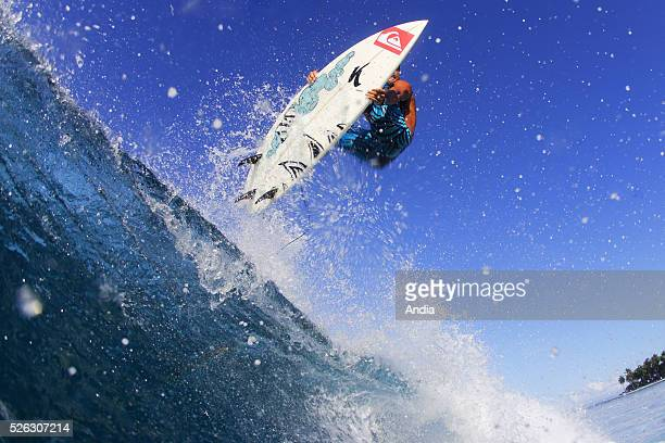 surfing lifestyle Outdoor boardsports to surf to go surfing surfer Surfing plank or board board water wave ocean jump figure or face Michel Bourez...