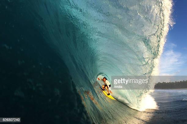 surfing lifestyle Outdoor boardsports to surf to go surfing surfer Surfing plank or board board water wave ocean watershot aqua aquatic water tube or...