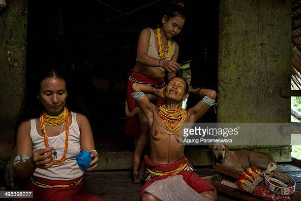 Mentawanese women prepare for Inauguration Ritual for Aman Gotdai as a New Sikerei on May 26 2014 in Butui Village Siberut Island West Sumatra...