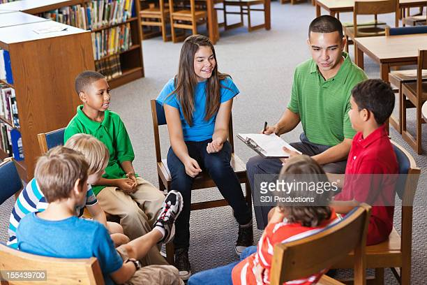 Mentor or teacher in discussion study group with students
