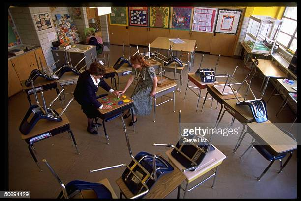 CITE mentor teacher Sandy Luebbe drilling Tracy Robinson intern in Cincinnati Initiative for Teacher Education program on using manipulatives in...