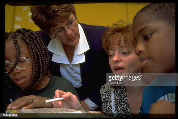 CITE mentor teacher Sandy Luebbe monitoring Cincinnati Initiative for Teacher Education program intern Tracy Robinson in teaching weather lesson to...