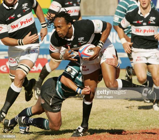 Mentz tackles Odwa Ndungane during the Absa Currie Cup match between Griquas and Sharks held at Absa Park on August 18, 2007 in Kimberley, South...