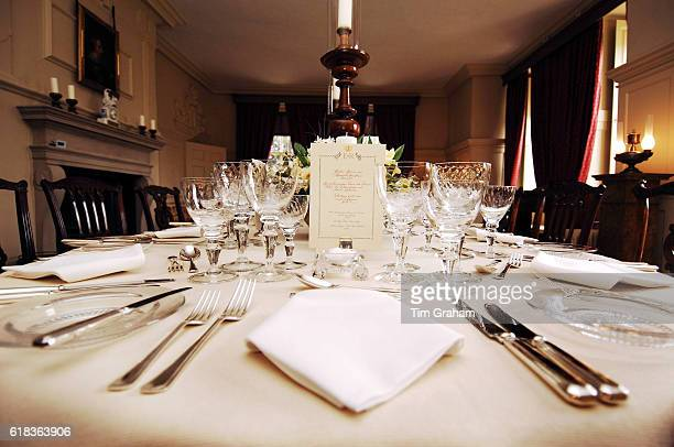 Menu and place settings at the long dinner table for the 80th birthday dinner for Queen Elizabeth II at Kew Palace