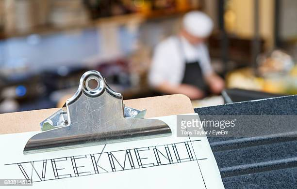 Menu On Clipboard With Cafe In Background At Restaurant