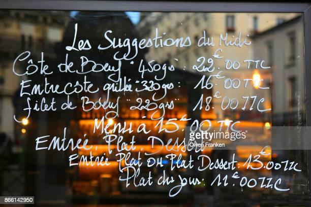 menu with prices written on a bistro window, Paris